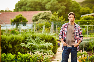 Buy stock photo Portrait of a smiling man standing in his organic garden