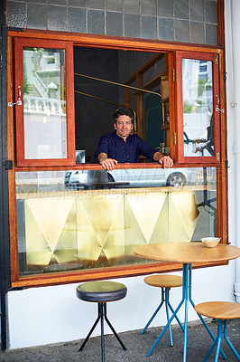 Buy stock photo Portrait of man looking through the takeaway window of his bakery cafe