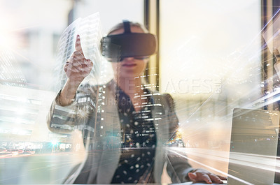 Buy stock photo Shot of a young businesswoman wearing a virtual reality headset at work