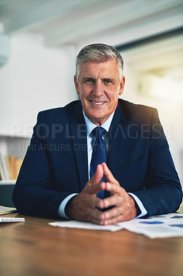 Buy stock photo Portrait of a confident businessman posing behind his desk