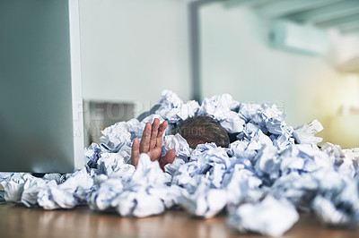 Buy stock photo Shot of an unidentifiable businessman drowning under a pile of paperwork