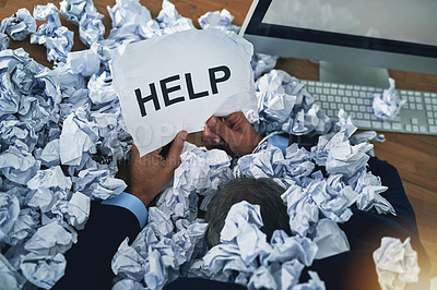 Buy stock photo Shot of an unidentifiable businessman asking for help while drowning under a pile of paperwork