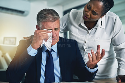 Buy stock photo Shot of a concerned businesswoman consoling her crying colleague at his desk