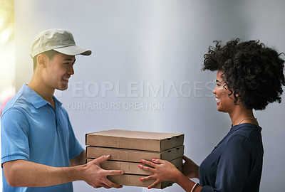 Buy stock photo Shot of a happy businesswoman accepting a pizza delivery from a delivery man in the office
