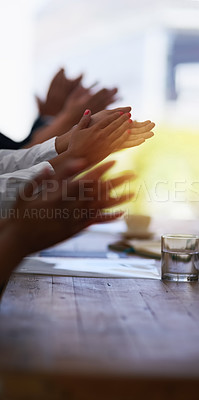 Buy stock photo Shot of a group of unidentifiable businesspeople applauding at the boardroom table