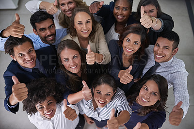 Buy stock photo High angle portrait of a group of coworkers showing a thumbs up in the office
