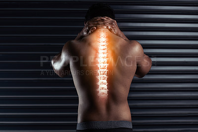 Buy stock photo Rearview shot of an athletic young man holding his back in pain during a workout