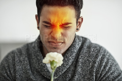 Buy stock photo Cropped shot of a young man suffering with allergies