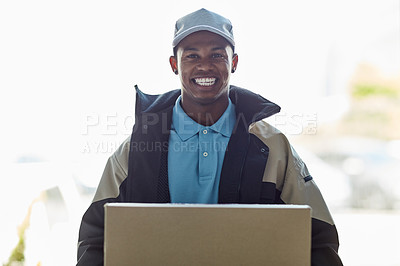 Buy stock photo Portrait of a courier holding a box for delivery
