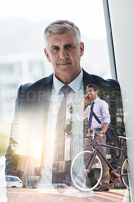 Buy stock photo Multiple exposure shot of a mature businessman superimposed over a young man riding a bicycle in the city