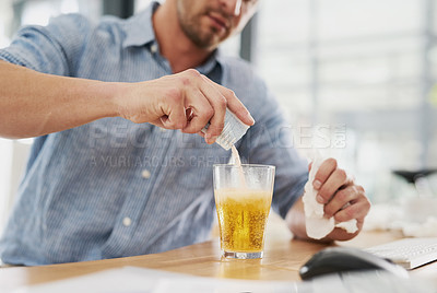 Buy stock photo Cropped shot of an unrecognisable businessman dissolving a sachet of medicine in a glass of water in an office