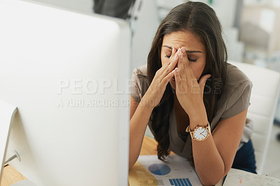 Buy stock photo Shot of an overwhelmed businesswoman sitting by her computer in the office