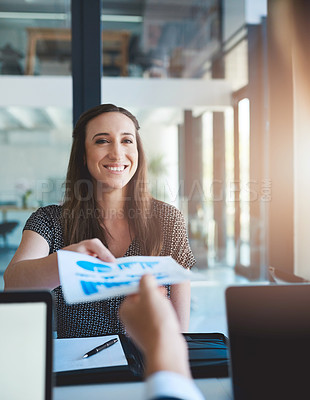 Buy stock photo Shot of an unidentifiable businessman handing a document to his colleague across the table in the office