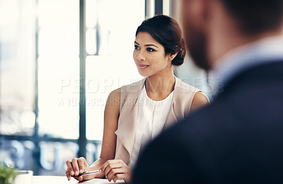 Buy stock photo Shot of businesspeople having a meeting in the boardroom