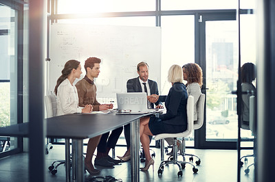 Buy stock photo Shot of a group of corporate businesspeople meeting in the boardroom