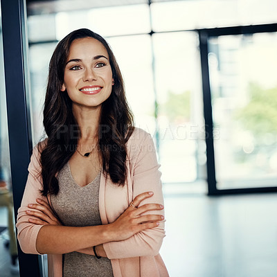 Buy stock photo Cropped shot of a confident young businesswoman standing in an office