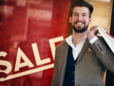 Buy stock photo Cropped shot of a young man out shopping