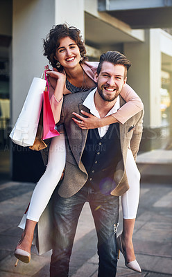 Buy stock photo Shot of a playful couple out on a shopping spree