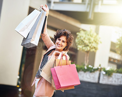 Buy stock photo Cropped shot of a young woman out on a shopping spree