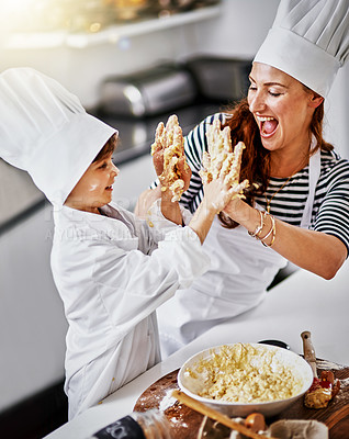 Buy stock photo Shot of a mother and her son baking in the kitchen