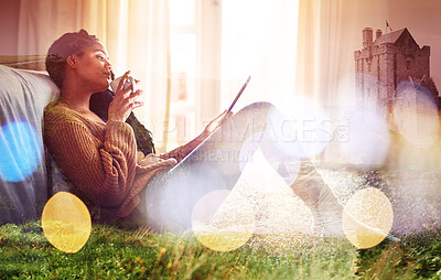 Buy stock photo Shot of a young woman using her tablet at home superimposed over a beautiful landscape