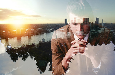 Buy stock photo Shot of a focused young businessman superimposed over a cityscape