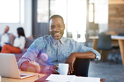 Buy stock photo Portrait of a smiling man sitting at his desk in an office with colleagues in the background