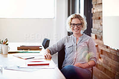 Buy stock photo Portrait of a confident young professional sitting at her desk in an office