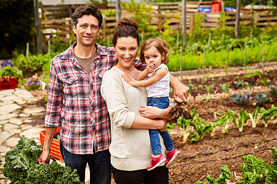 Buy stock photo Portrait of a couple with their little girl standing their organic garden
