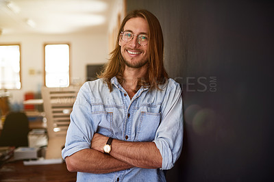 Buy stock photo Portrait of a smiling young designer standing with his arms crossed in an office
