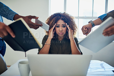 Buy stock photo Shot of a stressed out young woman working in a demanding career