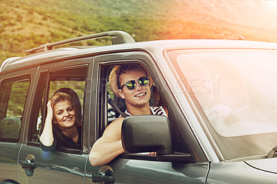 Buy stock photo Portrait of a young couple enjoying a roadtrip together