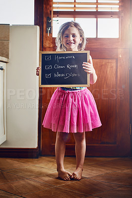 Buy stock photo Portrait of a little girl holding a chalkboard with chores written on at home