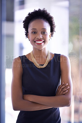 Buy stock photo Portrait of a confident and successful young businesswoman working in a modern office