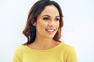 Buy stock photo Studio portrait of a gorgeous young woman posing against a light background