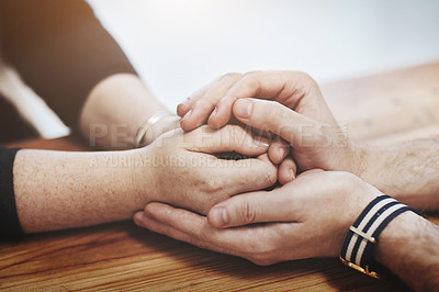 Buy stock photo Cropped shot of two people holding hands in comfort