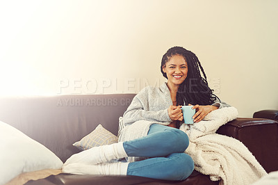 Buy stock photo Shot of a young woman enjoying a cup of coffee at home