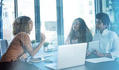 Buy stock photo Cropped shot of a group of businesswomen having a discussion in the boardroom