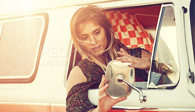 Buy stock photo Shot of a gorgeous young woman enjoying a roadtrip on her own