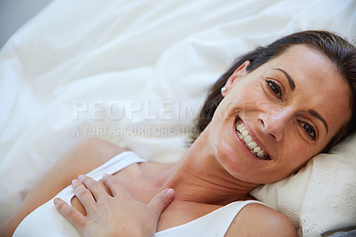 Buy stock photo Portrait of a woman relaxing in bed