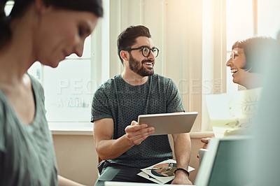 Buy stock photo Cropped shot of a group of young designers working together in the office