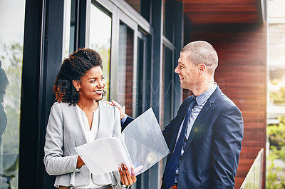 Buy stock photo Cropped shot of two businesspeople having a discussion outside an office