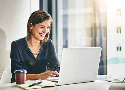 Buy stock photo Cropped shot of a young businesswoman working on a laptop in an office