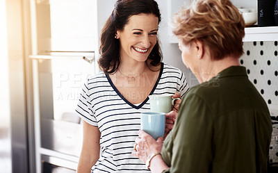 Buy stock photo Cropped shot of a woman and her elderly mother drinking coffee together at home