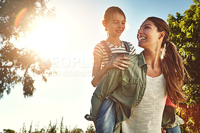 Buy stock photo Shot of a mother and her daughter bonding together outdoors