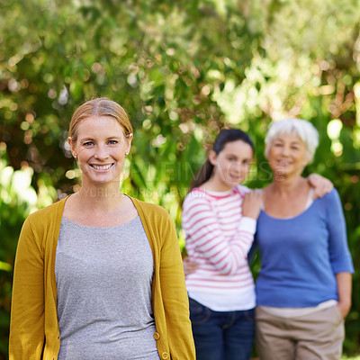 Buy stock photo Shot of three generations of family women standing outdoors