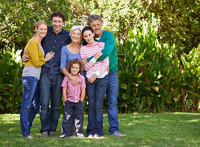 Buy stock photo Shot of a family posing for a photo
