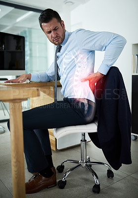 Buy stock photo Shot of a young businessman experiencing back pain highlighted in glowing red at work