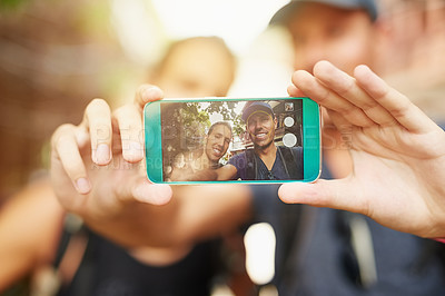 Buy stock photo Shot of two young friends taking a selfie while traveling together in Thailand