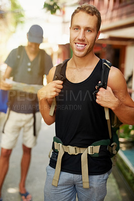 Buy stock photo Portrait of two smiling young friends wearing backpacks traveling together in Thailand